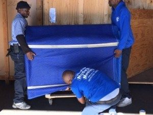 My Guys Movers padding furniture